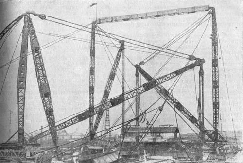 Жесткие и вантовые деррики на сборке Большого Устьинского моста